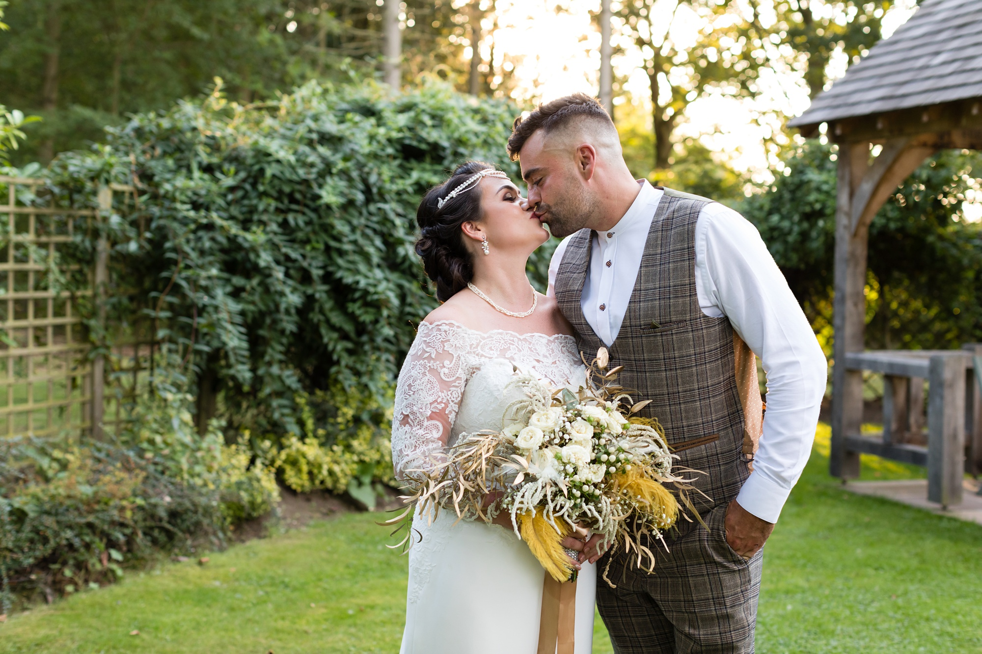 Bride & Groom kissing in the golden hour at Sandburn Hall.