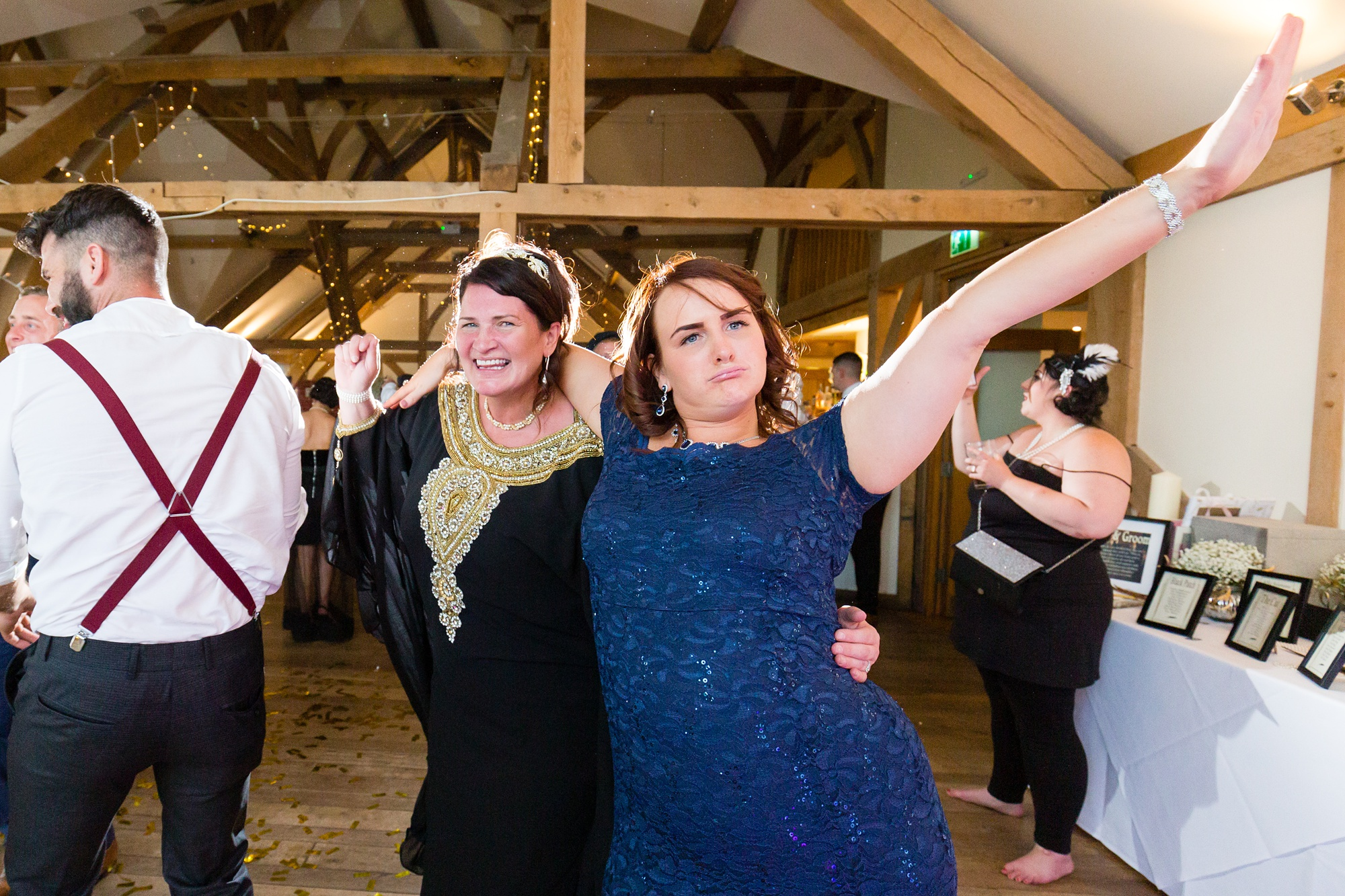 Guests dancing at York wedding with woman in blue dress.