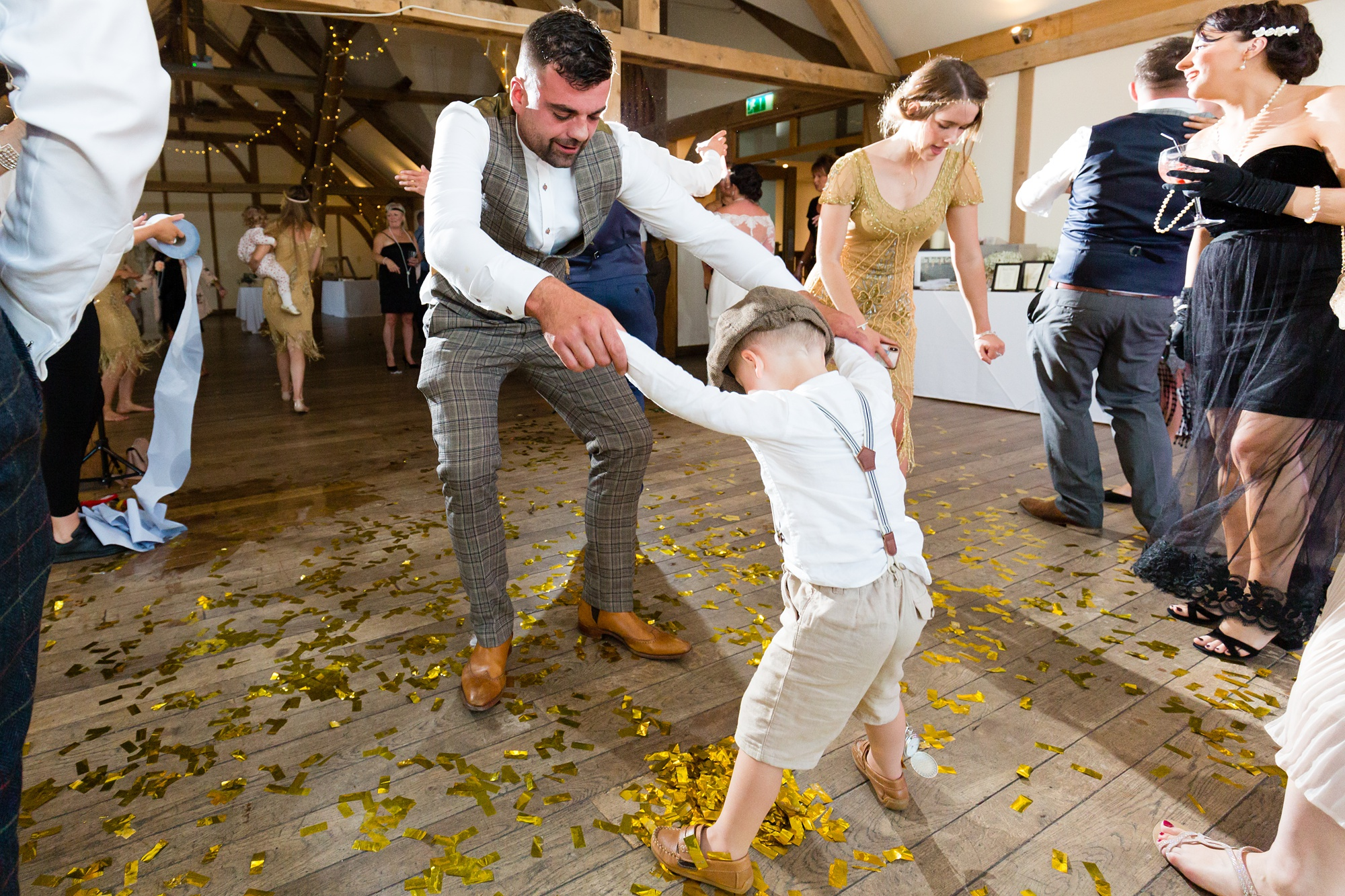 Groom dances with pageboy at Sandburn Hall wedding.