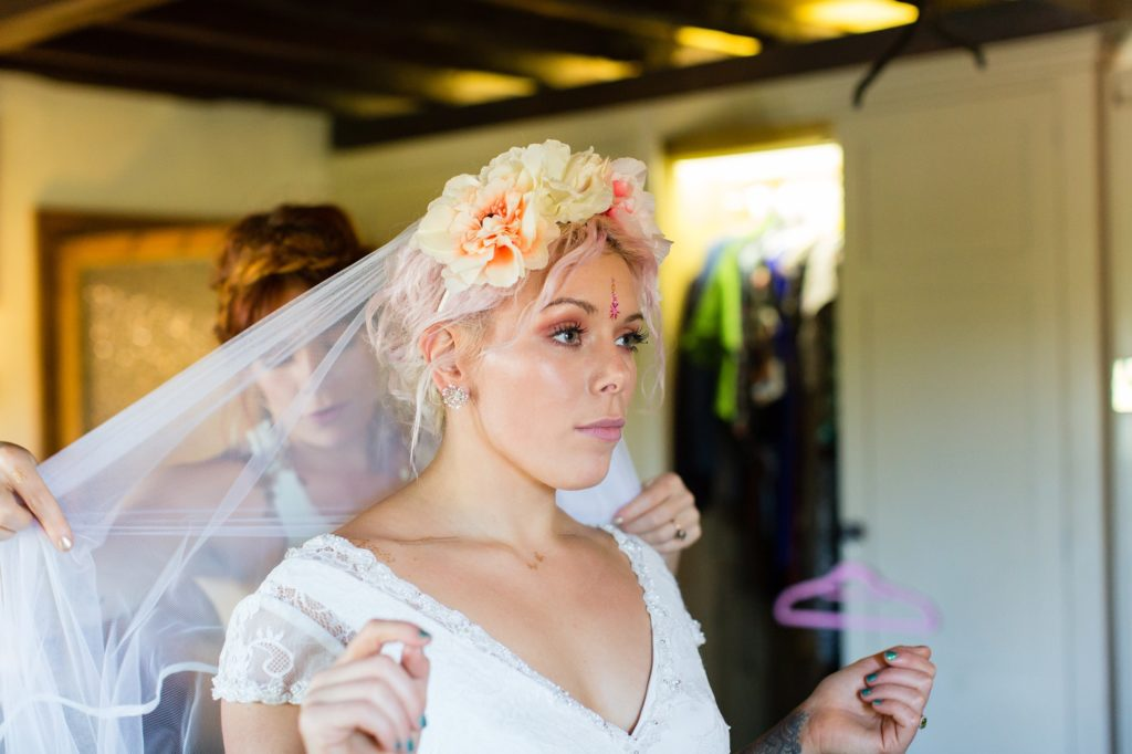 Bride's sister arranges her veil at Yorkshire wedding.