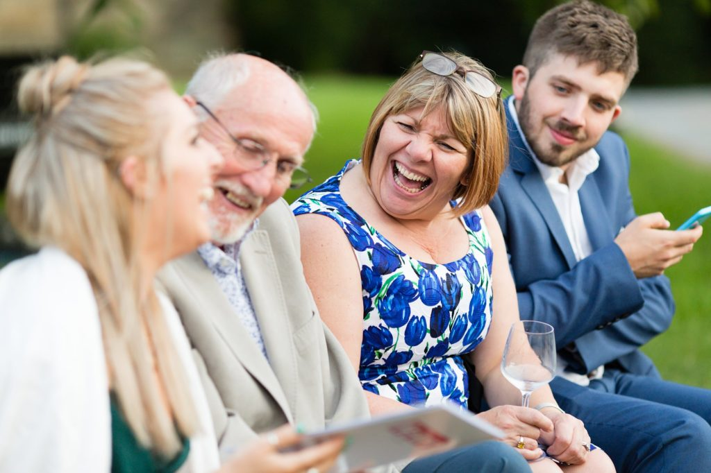 Guests laughing at wedding at East Riddlesden Hall