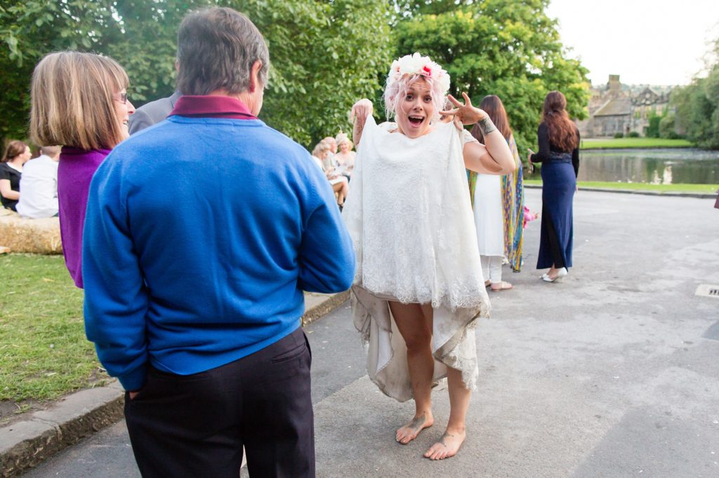 Silly bride shows off dress with a dirty hem at fun wedding in Yorkshire