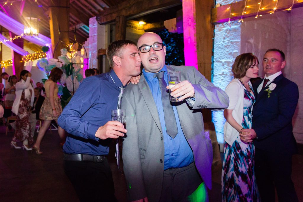 Guests making silly faces at wedding party